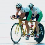 Blind tandem cyclist. Photo credit: By Australian Paralympic Committee, CC BY-SA 3.0, https://commons.wikimedia.org/w/index.php?curid=15865922