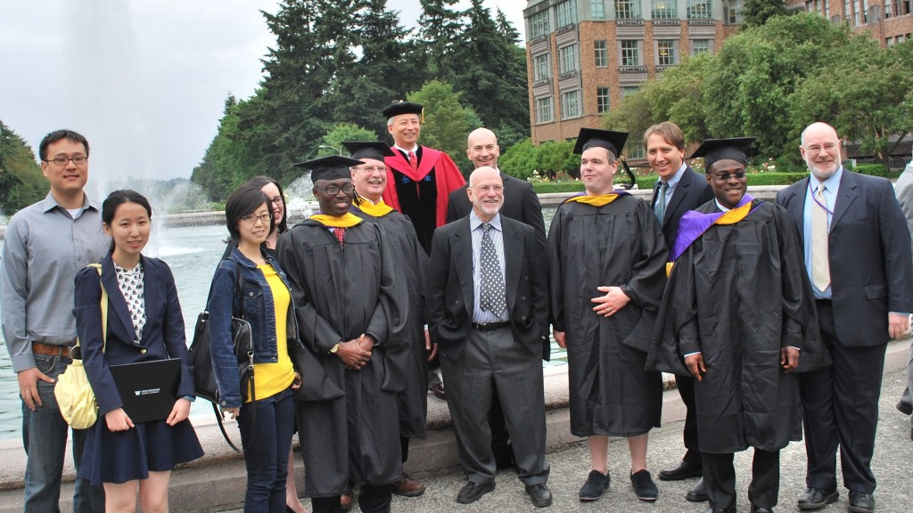 CFRM faculty, students, and their families at graduation in 2014