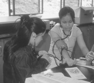 Picture of student taking blood pressure measurement