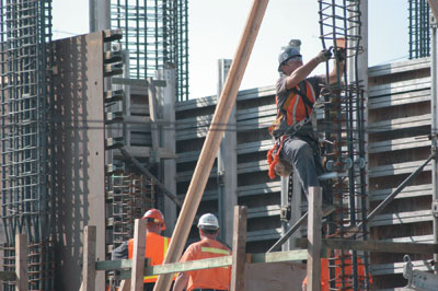 at the construction site an iron worker prepares rebar for concrete forms rebar worker