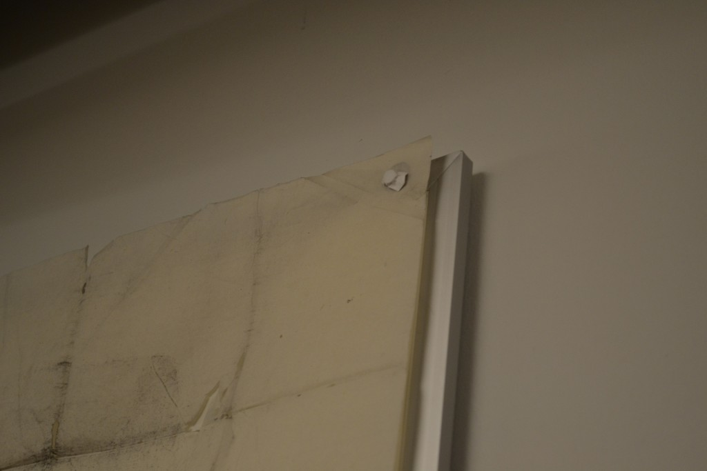 Preservation/Conservation's ingenious technique for securing the rubbings to the wall for display—it involved magnetic stripping and small, paper-wrapped magnets, to affix the rubbings securely without  damaging them.