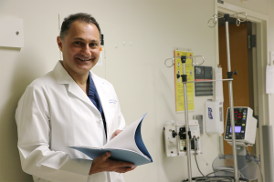 HIPRC Injury Care section lead Saman Arbabi, M.D., reviews a file at Harborview Medical Center.