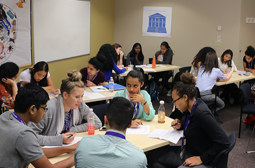 INSIGHT high school students work in groups on an epidemiology activity.