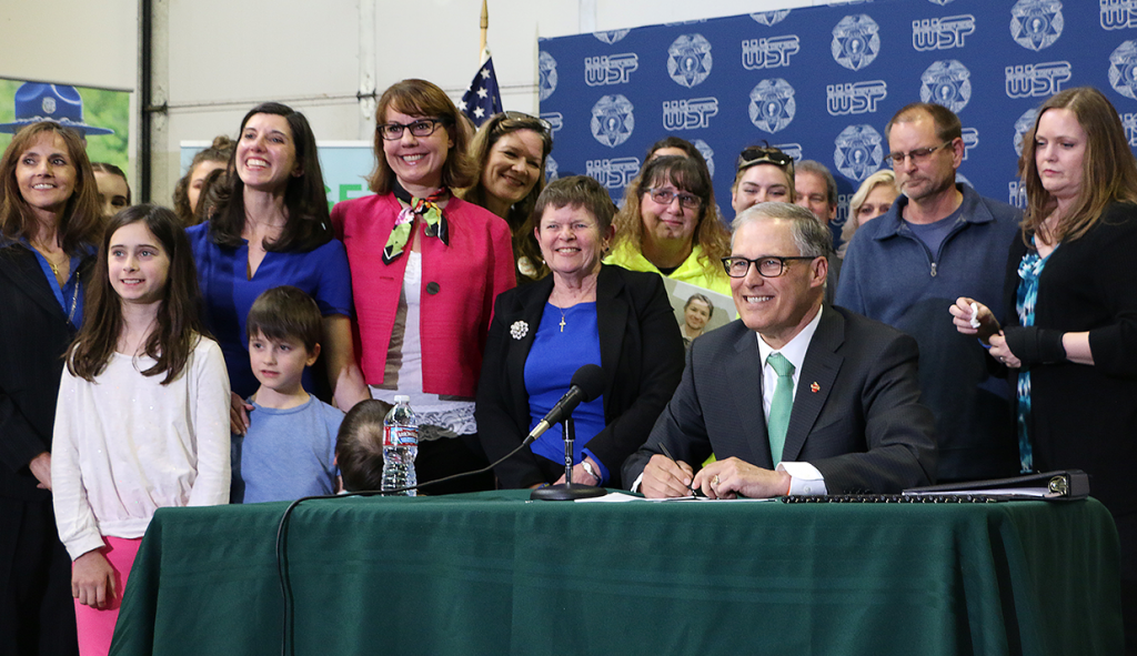 Gov. Jay Inslee signs the distracted driving bill.