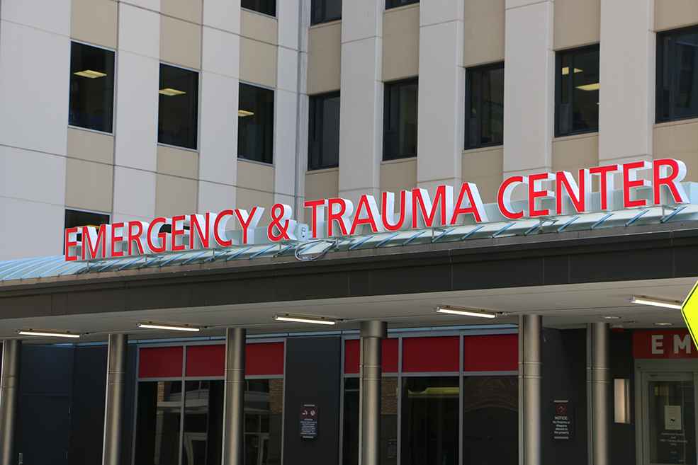 "The emergency entrance at Harborview Medical Center, with the sign ""Emergency and Trauma Center."""