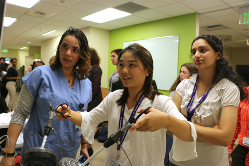 A visit to the HMC WISH lab gives students the chance to try out real medical training equipment.
