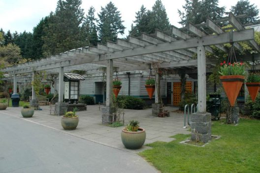building with pergola and planted containers