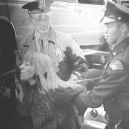 Judy Bissell being arrested during the Perfect Photo Strike, 1969.