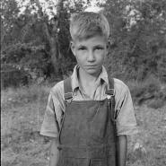 Migratory boy in squatter camp. Has come to Yakima Valley for the third year to pick hops.