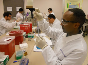Students At Counter Using Pipettes Program Description. The Medical  Laboratory ...