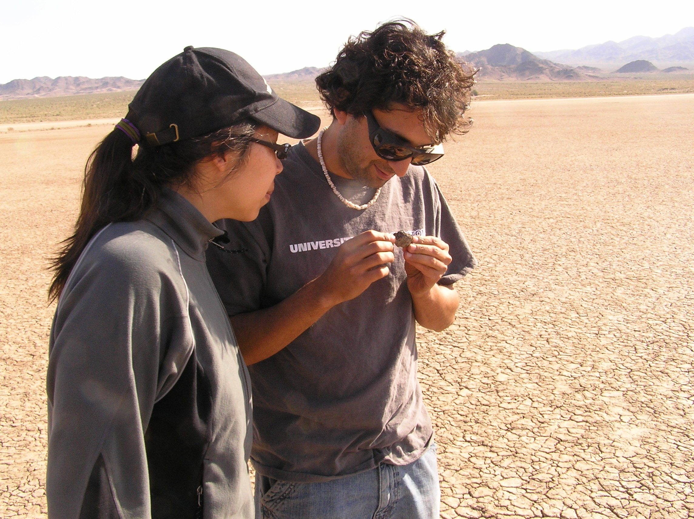 Graduate student Rika Anderson (Univ. of Washington) and Postdoc Sanjoy Som (NASA Ames) examine a rock for cryptoendolithic cyanobacteria in the Mojave Desert.