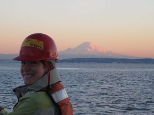 Researcher and Mount Rainier as seen from deck of R/V Barnes