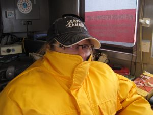 Researcher bundled up in foul weather gear