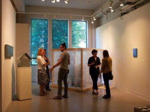 Artist Troy Gua (center) at Mad Home Away From Home opening; photo by Jeanette Mills