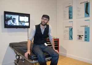 Kris Martin with his Code Blue project at the 2010 MFA exhibit at the Henry Art Gallery; photo by Mary Levin