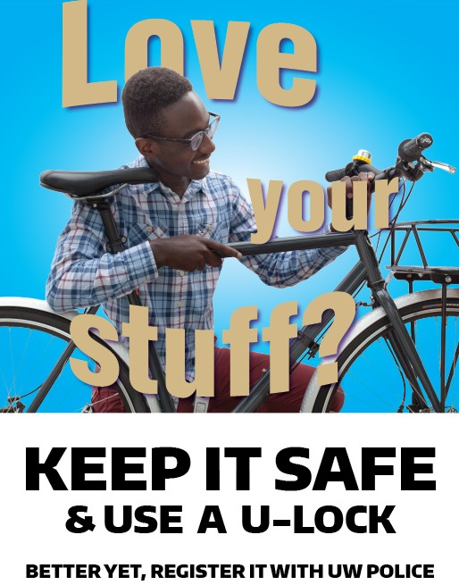 Man Smiling at bike. Keep it safe and use a u-lock. Better yet, register it with UW Police.