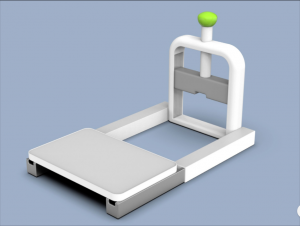 Prototype of swivel station with cutting board at one end with metal bars connecting to a blade that can be pushed down with a blade