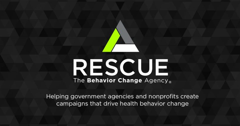 """Tessellated triangle background in vary shades of gray, with a brighter single, central triangle in green, grey, and white. White central text reads, """"Rescue; The Behavior Change Agency"""". Text below that reads, """"Helping government agencies and nonprofits create campaigns that drive health behavior change."""""""