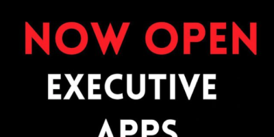 """central white and red text on a black background reads """"2021 - 2022 Now Open Executive Apps"""". Smaller text reads """"TEDxUofW, x=independently organized TED event"""""""
