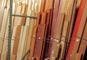 Close view of wood plank storage in a lumbar warehouse setting