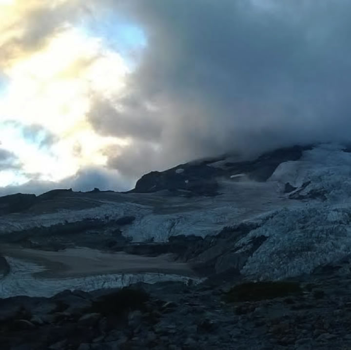a view of the snowfield at sunset