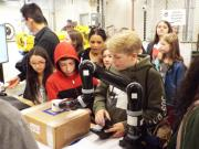 Children using robotic arm in BARC lab