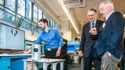 Jim Buttrick (right), a Boeing engineer and the associate director of the Boeing Advanced Research Center at the University of Washington, describes the workings of a mobile vehicle equipped with multiple sensors to Gov. Jay Inslee of Washington.