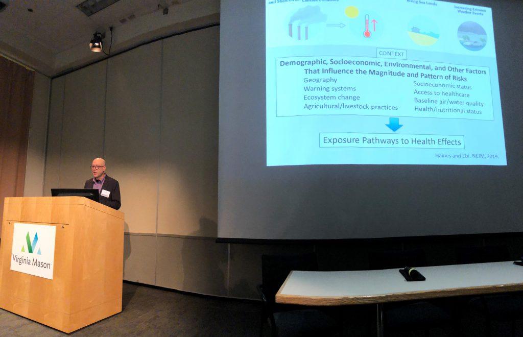 Dr. Jeff Duchin standing at podium