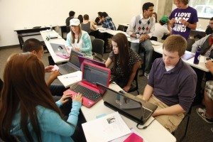 Students with Laptops in Classroom