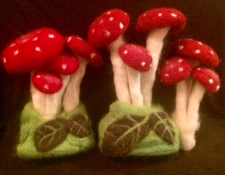 Three clusters of red felted mushrooms