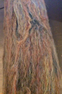 Felted tree trunk with rust, black, and tan stripes by Kaylin Francis