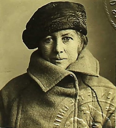 Idenitification photo of Sara Wrenn in coat and hat, marked with official seal.