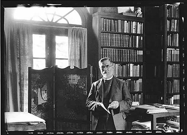 man with a book in a library