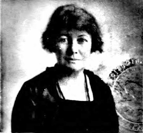 Black and white photo of a woman, showing official seal.