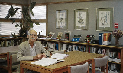 man working at a table in the library