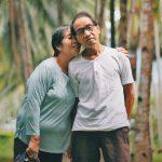 Older Asian American Pacific Islander couple hugging