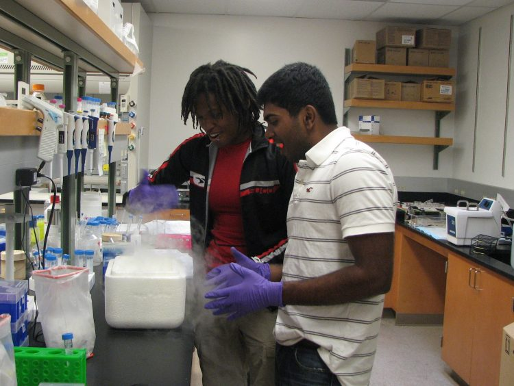 Student with mentor in research lab