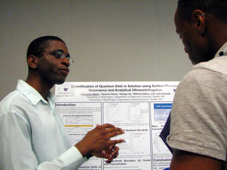 Student presenting at poster session