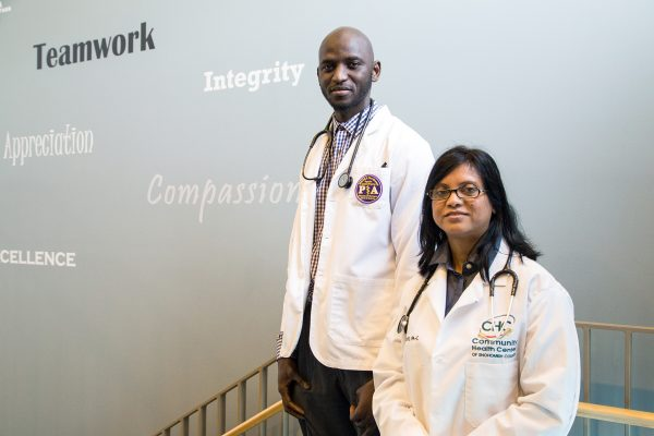 Ismail Jatta with Rizwana Lott, PA-C, at Community Health Center of Snohomish County, site of his 4-month family medicine preceptorship.