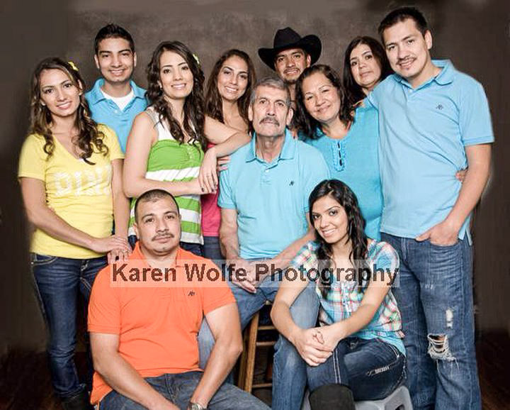 Simon Mendoza in a family photo with his parents and eight brothers and sisters.