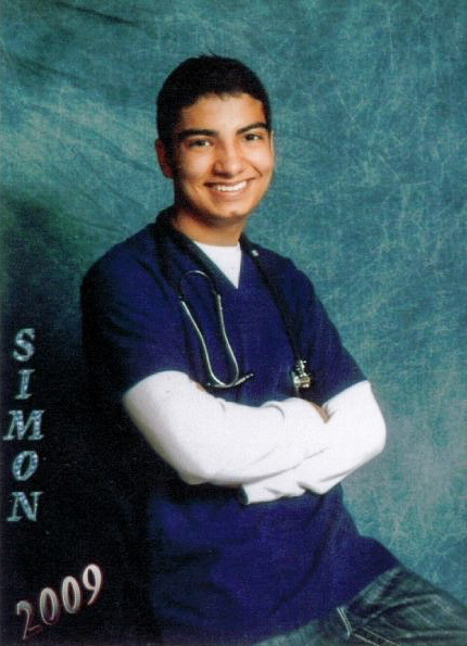 Simon Mendoza at age 17 as a Certified Nurse Assistant.