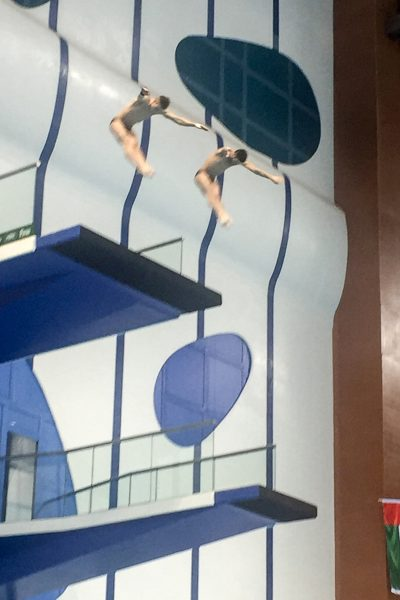 Athletes diving from the 10-meter platform in Dubai.