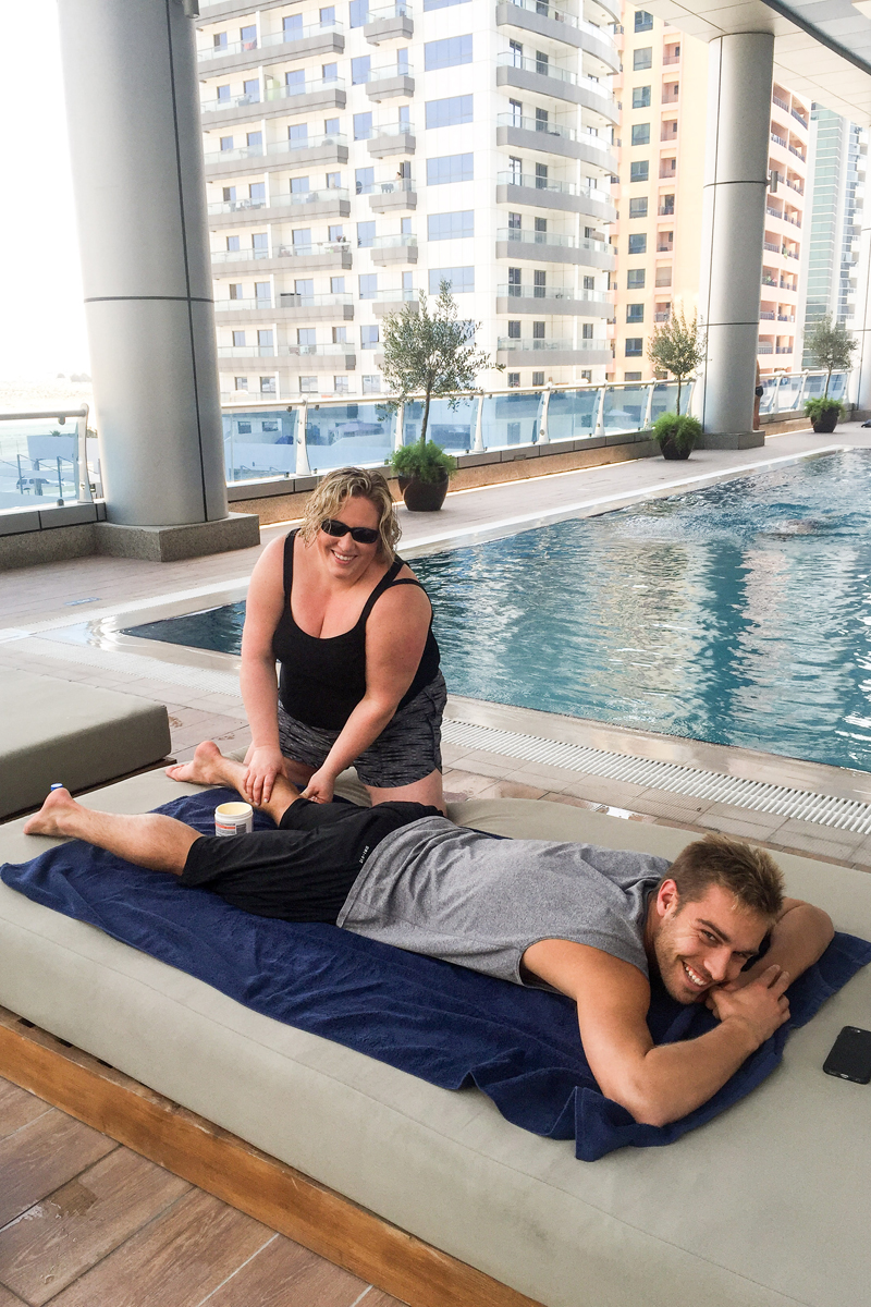 Jen providing treatment to Kristian Ipsen by the hotel pool in Dubai.