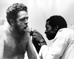 Charles Phillips examining patient
