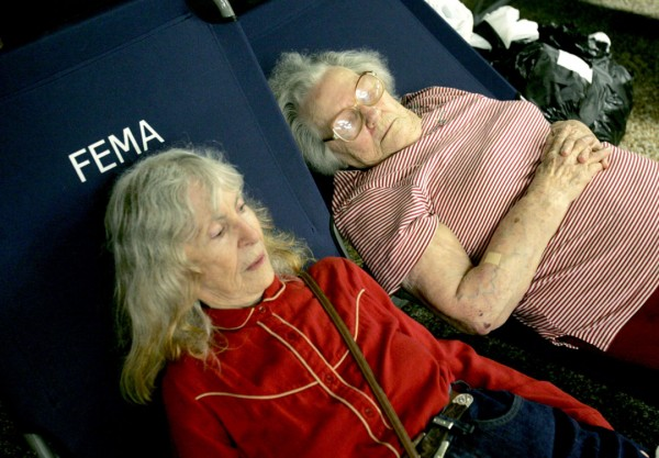 Photo of two elderly women recovering at the FEMA shelter in Houma, LA