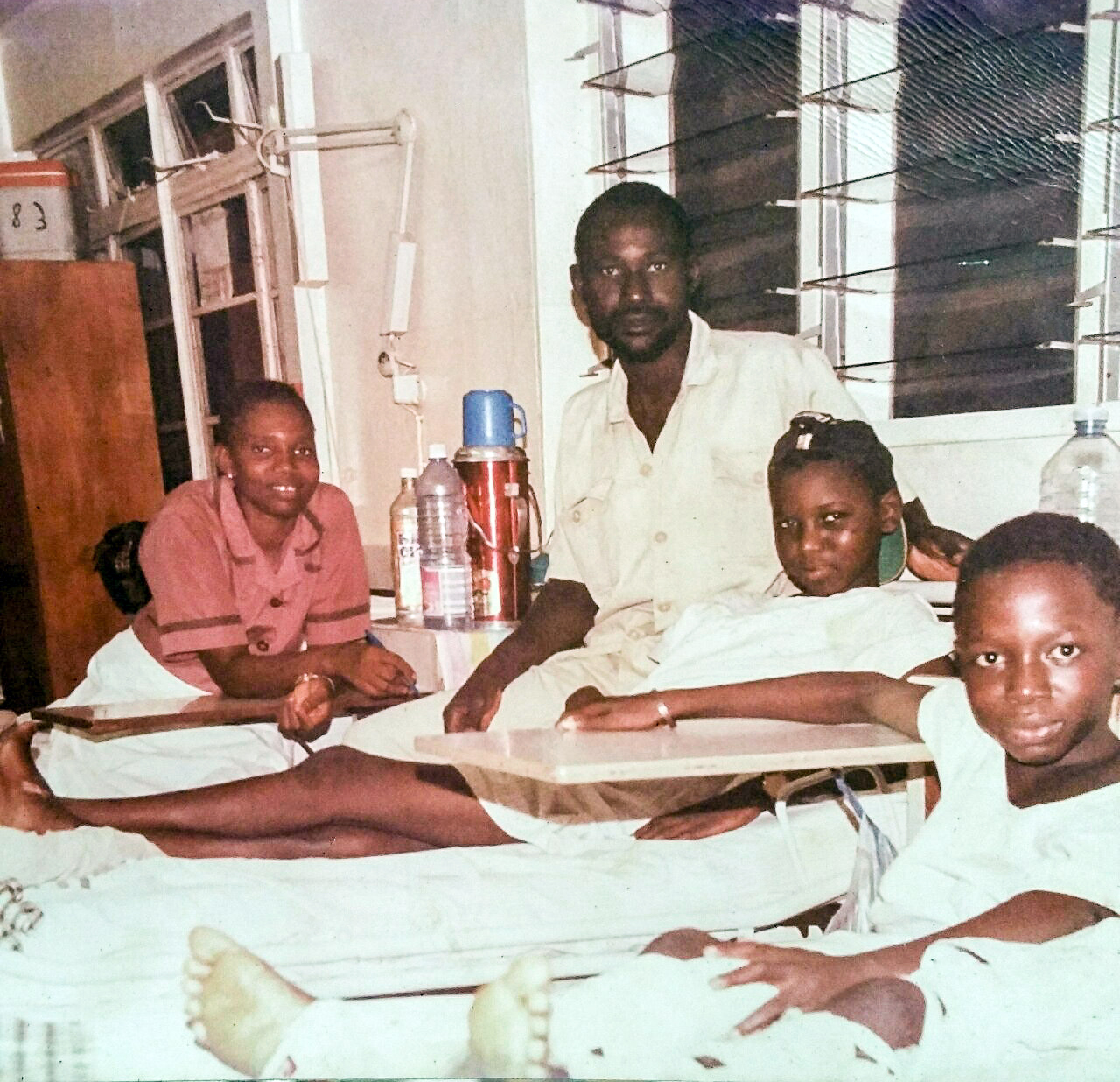 Ismail (second from left) at age 13 in a Gambia hospital recovering from a fractured femur, an injury that was to follow him into adulthood. At the far right is his nurse, and the hospital custodian. At the right is his bed neighbor.