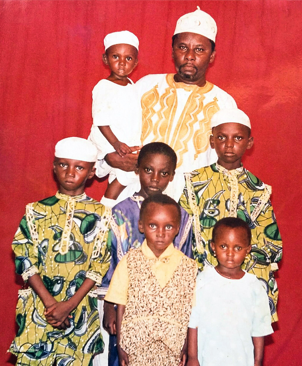 A young Ismail Jatta with his father, three brothers and cousins in his native Gambia, West Africa. Ismail is the tallest at the right.