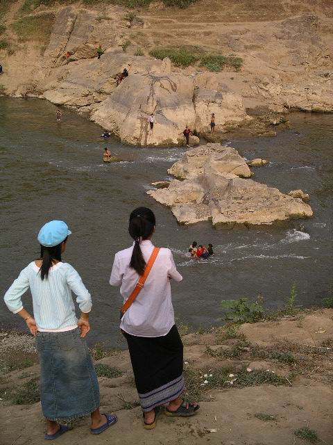 Lao youth at the confluence of the Mekong & Kahn rivers in Luang Prabang.