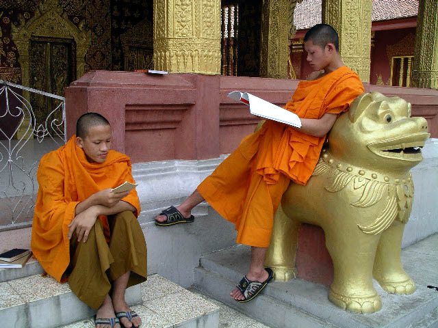 Young monks studying outside the temple in Luong Prabang.