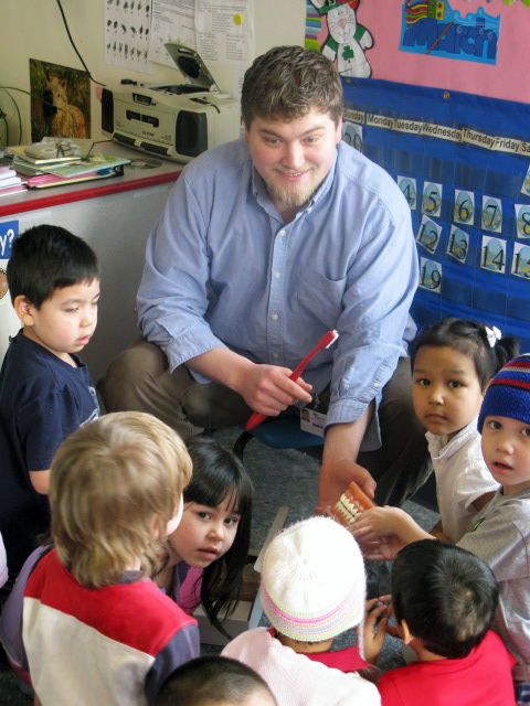 DHAT Ben Stewart teaches Alaskan children proper dental hygiene during a Southcentral Foundation Head Start session.